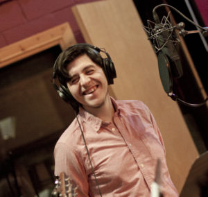 Sam Valladares smiling in the recording studio picture